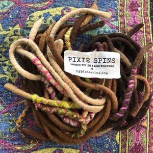 Pixie spins faux dreadlocks extensions